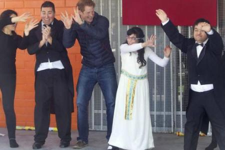 (Video) Prince Harry boogies and charms on charity tour