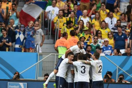 Late goals see France through to the quarter-finals