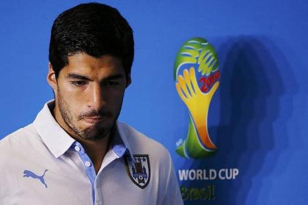 Suarez vows not to bite again after apologising to Chiellini
