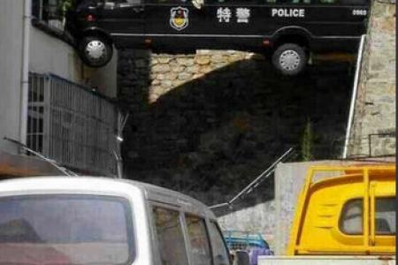 Is this policeman the worst driver ever?