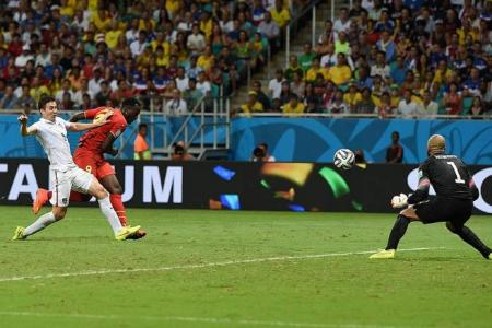 Belgium down the US in extra time to make last eight