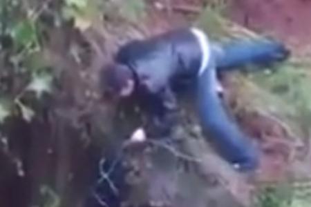 Video: Man seen saving dog during Brazilian floods