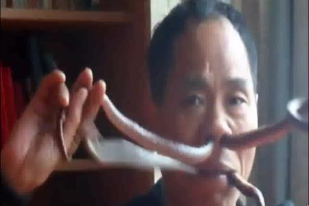 VIDEO: How did this man make a snake slither out of his nostril?