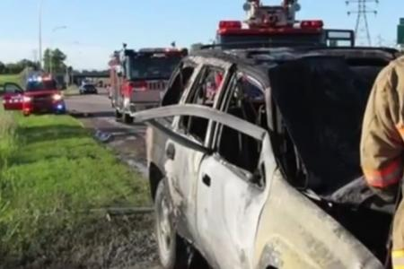 Hero uses bare hands to free driver from burning SUV