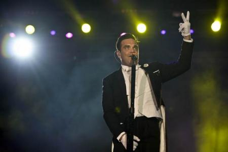 Robbie Williams falls off stage, breaks woman's arm