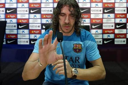 Puyol warns Suarez to behave if he moves to Barca