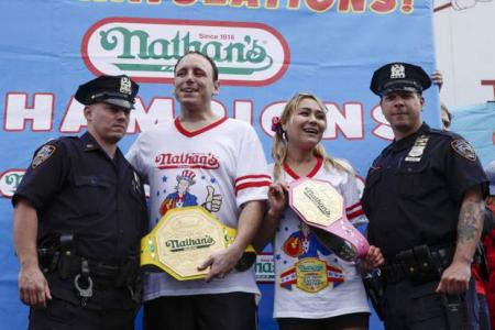 Hotdog eating champ proposes to gf before inhaling 61 dogs