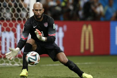 Tim Howard makes another great block - against enthusiastic fan