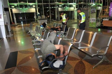 Workers sleep at M'sia immigration after a day's work in S'pore
