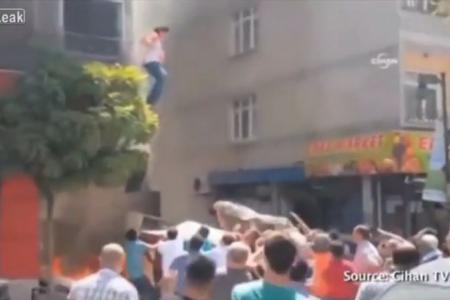 (Video) Pregnant woman jumps from burning building