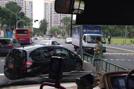 Road bully blocks SBS bus with his car
