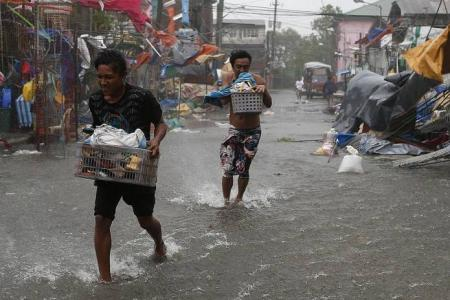 Hundreds of thousands evacuated as typhoon batters the Philippines
