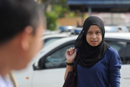 Police detain M'sian woman who attacked elderly man's car