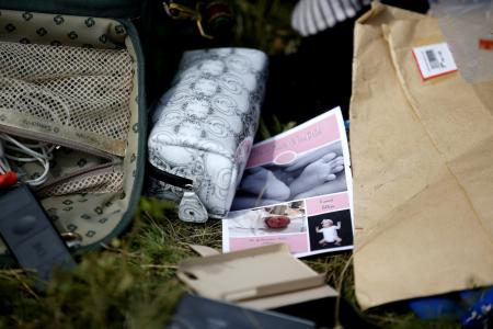 Reporter under fire for going through MH17 passenger's luggage
