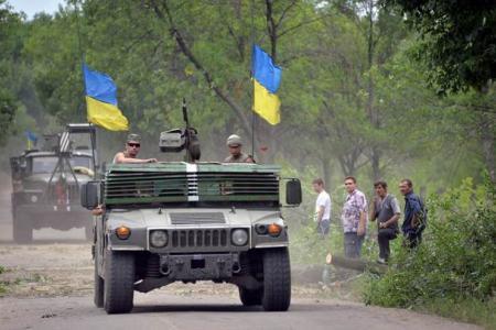 Deadly fighting rages on in east Ukraine despite plane crash