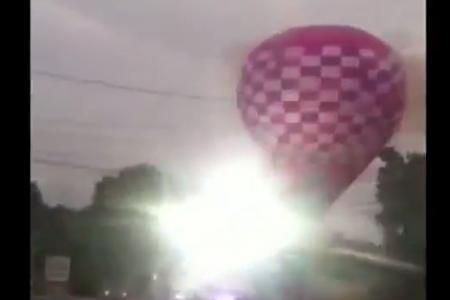 Shocking footage of hot air balloon crashing into powerlines