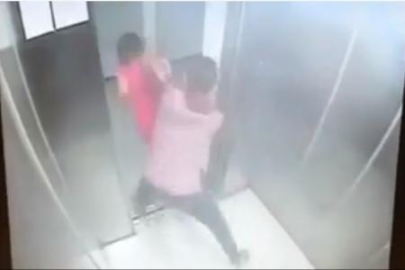 Man snatches purse as woman leaves lift