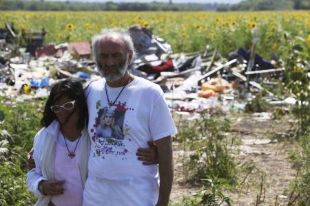 Heartbroken victim's parents visit MH17 site