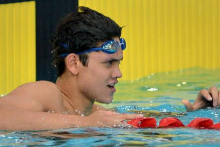 Schooling sets new national record in 100m fly