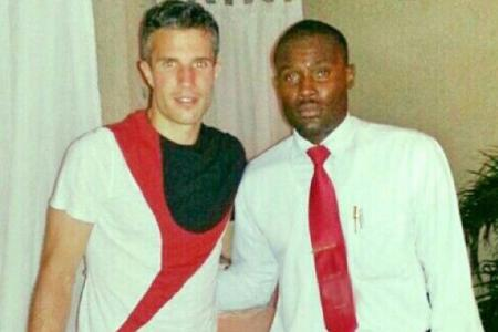 Waiter suspended over photo with RVP
