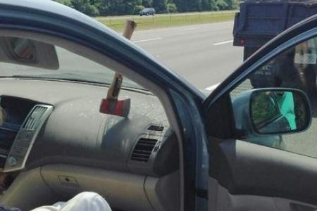 Near miss for woman after axe smashes through windscreen