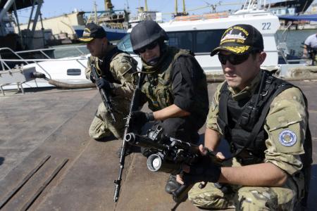Blasts as experts finally reach MH17 crash site in Ukraine