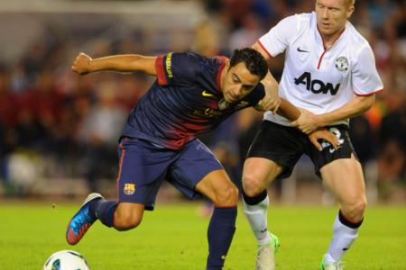 Which Man Utd player does Xavi regret not playing with?