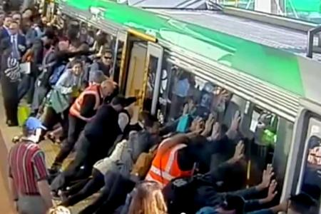 Commuters tilt train to save trapped man