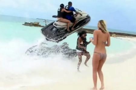 Watch flying jetski as it narrowly misses woman's head