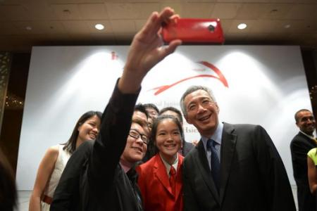 PM Lee marks a decade as Singapore's leader on Facebook