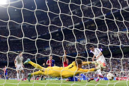 Champions League holders Real back on song with 5-1 rout of Basel