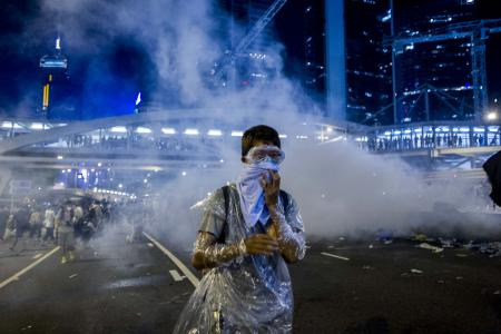 HK police surprise protesters with tear gas