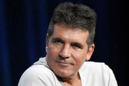 X-Factor judge Simon Cowell says no to showing... dolphins in captivity