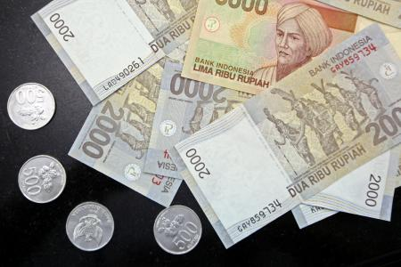 Indonesian officials ordered to pay $105 for second wife