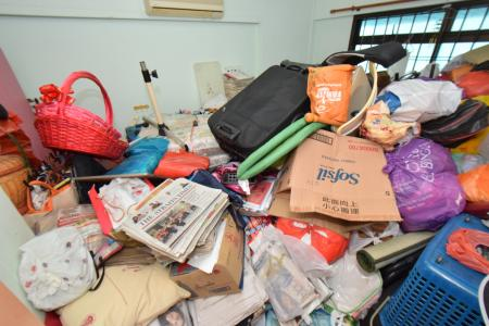 Junk from one flat fills five large trash containers