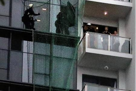 High drama as woman sits on 14th storey ledge for 3 hours