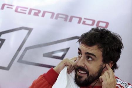 F1 racing: Watch as Fernando Alonso becomes a fireman when Ferrari engine bursts into flames