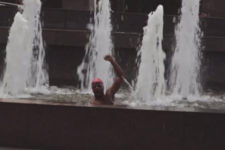 WATCH: Man swims in Ngee Ann City fountain to support S'pore athletes