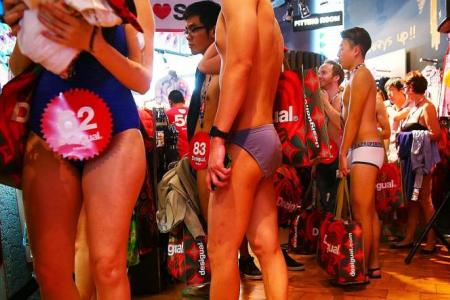 Bargain-hunters told to dress in swimwear but...bikini antics too naughty for Orchard Rd?