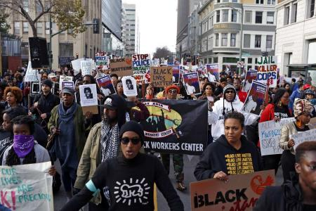 Thousands rally in US cities to protest police killings
