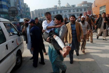 Taleban attack on Pakistan school leaves more than 130 people dead