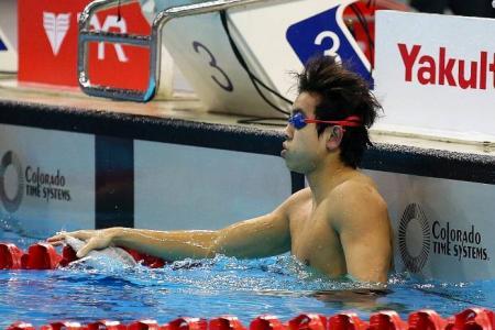 U-17 100m free record-breaker Darren Lim avoids the media