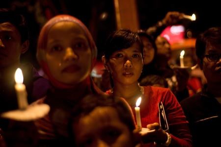 New Year celebrations in Malaysia and Indonesia sombre amidst floods and AirAsia tragedy