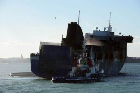 Italian ferry which caught fire arrives in port