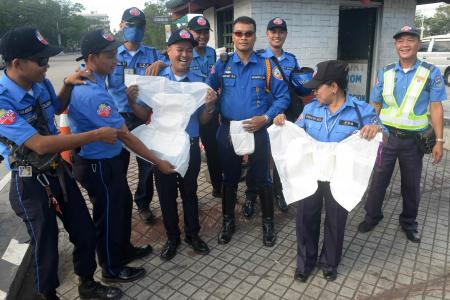 Philippine traffic officers told to wear adult diapers during Pope's visit