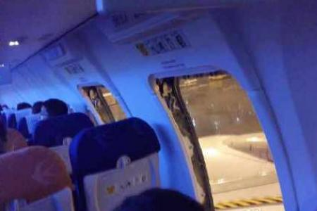 Air rage: Chinese passengers open plane's emergency doors to protest flight delay