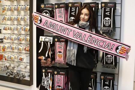 "Football fans call Kim Lim ""Angel of Valencia"""