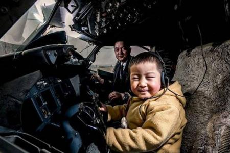 Boy, four, who lost both his legs in an accident, gets to 'fly' aircraft