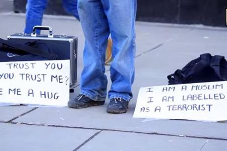 WATCH: Blindfolded Muslim man asks Canadians to show trust by hugging him