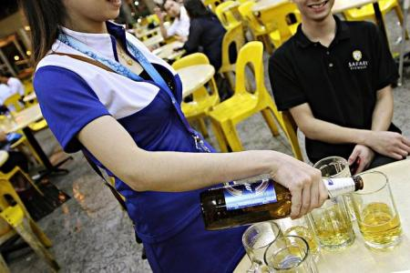 Shorter skirts, more business for a beer promoter